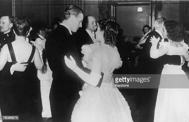 Princess Elizabeth dances with her fiance Philip Mountbatten in public for the first time at a ball at the Assembly Rooms Edinburgh 15th July 1947