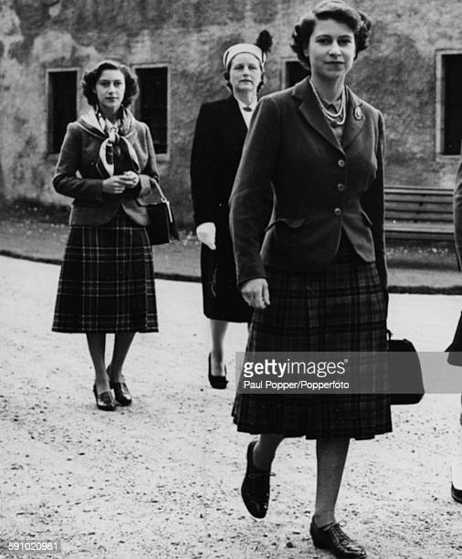 Princess Elizabeth followed by Princess Margaret on their way to listen to the pipe band of the Argyll and Sutherland Highlanders of Canada at...