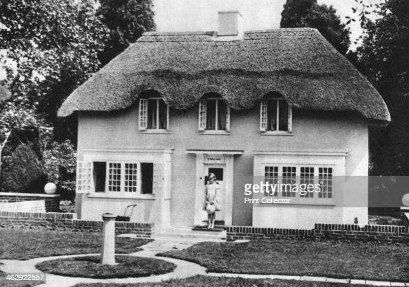Princess Elizabeth future Queen Elizabeth II of Great Britain Windsor 1930s Elizabeth as a child on the steps of Y Bwthn Bach the playhouse given to...