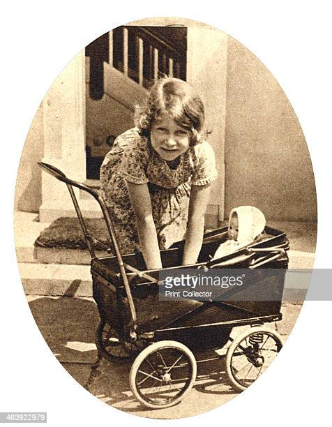 Princess Elizabeth future Queen Elizabeth II of Great Britain Windsor 1930s Princess Elizabeth as a child playing with one of her dolls outside Y...
