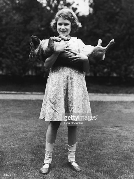 Princess Elizabeth holding a corgi dog