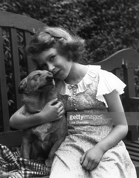 Princess Elizabeth in the grounds of her London home 145 Piccadilly with a pet dog