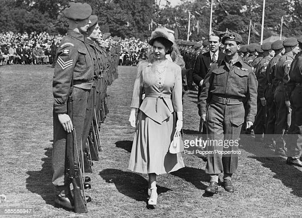 Princess Elizabeth inspects a Guard of Honor of the 7th Battalion Royal Warwickshire Regiment at the War Memorial Park in Coventry May 22nd 1948