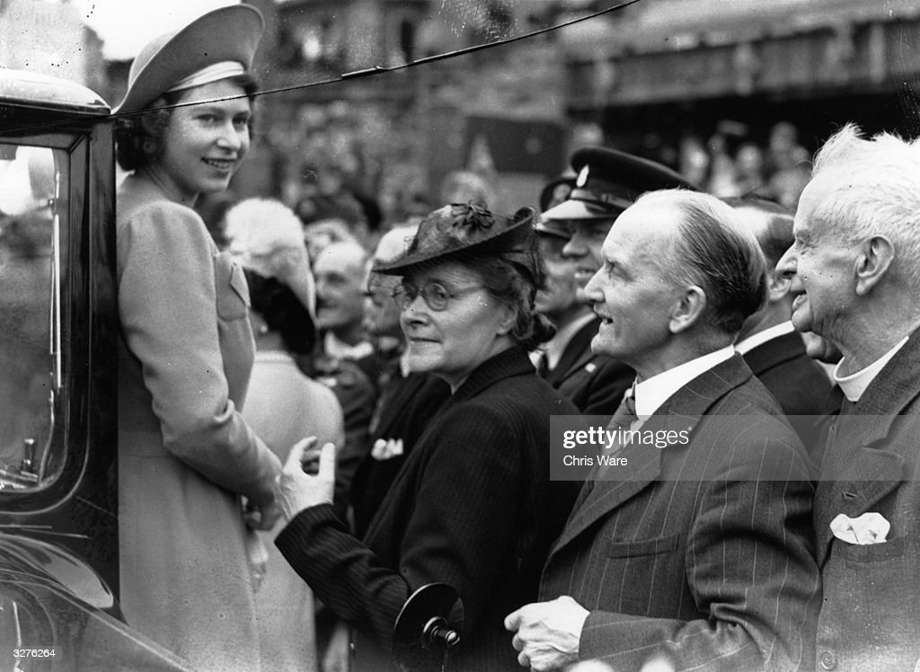 Princess Elizabeth is greeted by crowds as she tours the East End of London on the day after VE Day.
