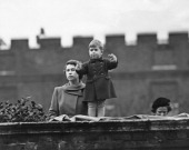 Princess Elizabeth left and Prince Charles watching a procession during the visit of Queen Juliana of the Netherlands from the wall of Clarence House...