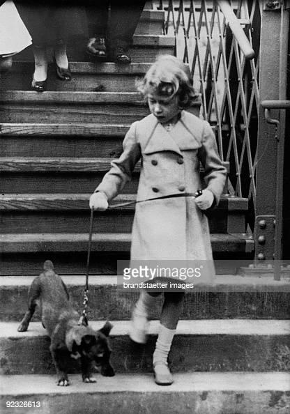Princess Elizabeth of England takes her dog for a walk Photograph Around 1931