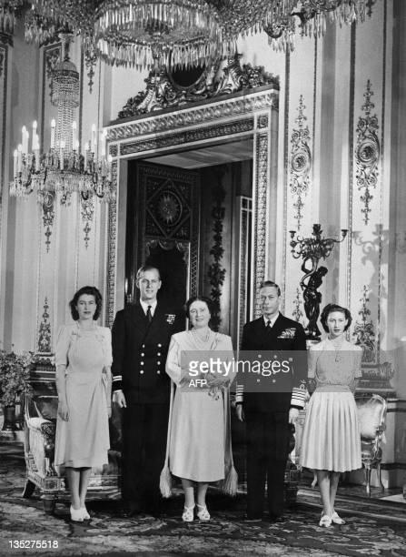 Princess Elizabeth Philip Mountbatten Queen Elizabeth King George VI and Princess Margaret pose in the Buckingham Palace on July 09 1947 in London...