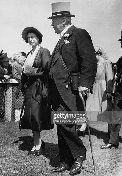Princess Elizabeth pictured with Harry Primrose 6th Earl of Rosebery on the course at Epsom Races England June 1st 1951
