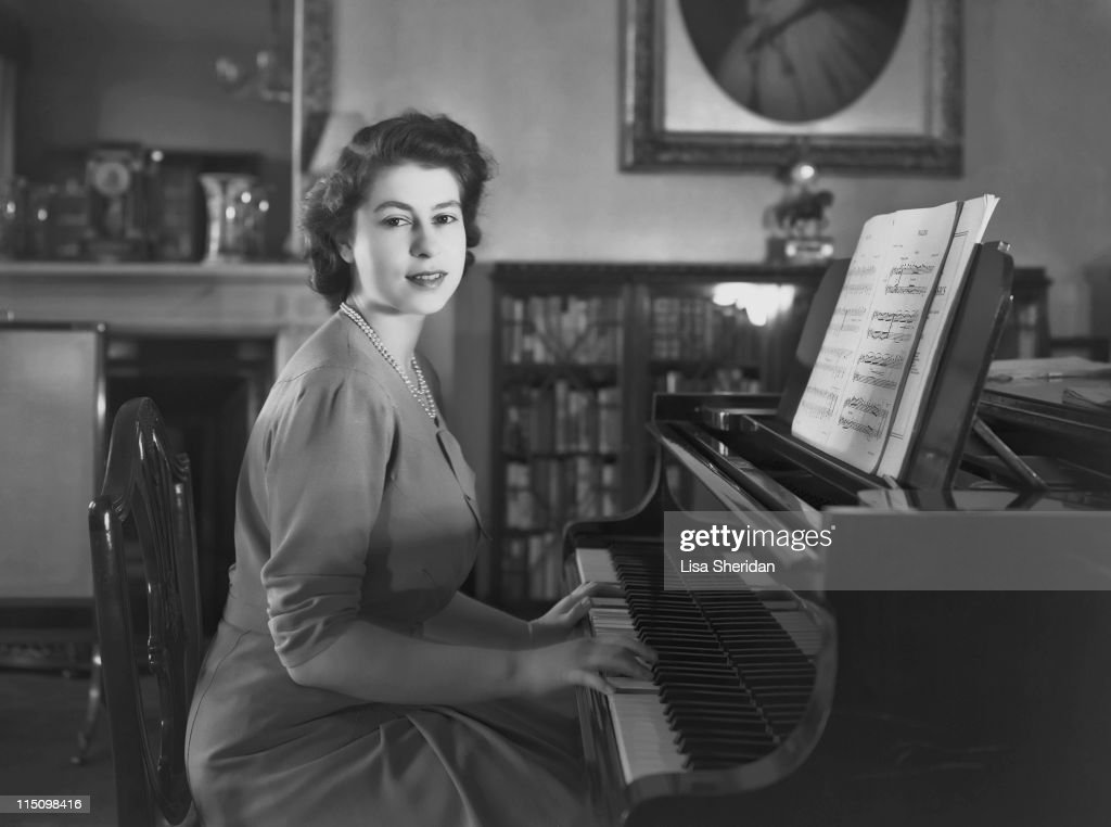Princess Elizabeth playing the piano in Buckingham Palace on July 19, 1946.