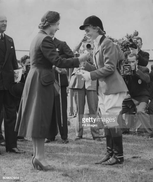 Princess Elizabeth presents her own Cup to Iris Kellett of Dublin who for the second time had won the jumping competition for the Princess Elizabeth...