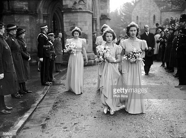 Princess Elizabeth Princess Alexandra of Kent and Princess Margaret leave Romsey Abbey Hampshire in their bridesmaids' dresses after attending the...