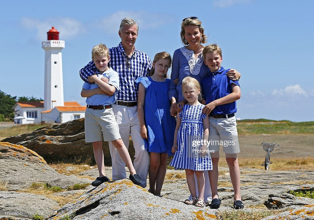 Princess Elizabeth, Queen Mathilde, Princess Eleonore, Prince Gabriel, King Philippe and Prince Emmanuel of Belgium pose during their holiday on l'Ile d'Yeu on July 24, 2013 in Yeu, France.