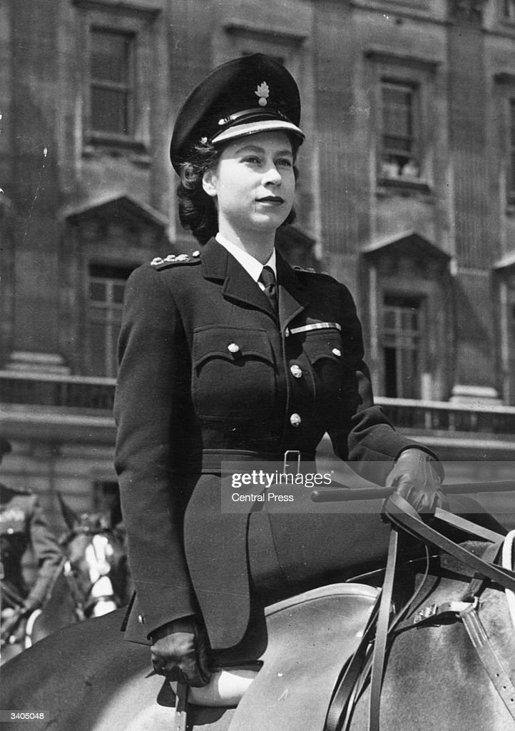 Princess Elizabeth (later Queen <a gi-track='captionPersonalityLinkClicked' href=/galleries/search?phrase=Elizabeth+II&family=editorial&specificpeople=67226 ng-click='$event.stopPropagation()'>Elizabeth II</a>) sitting side saddle on horseback, in uniform as Colonel-in-Chief of the Grenadier Guards.