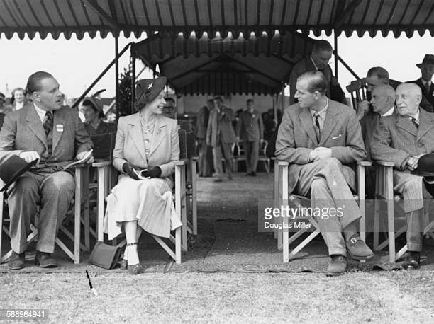 Princess Elizabeth talking to Prince Philip the Duke of Edinburgh at the Royal Horse Show at Windsor England May 12th 1949