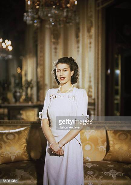 Princess Elizabeth the future Queen Elizabeth II in the state apartments at Buckingham Palace during her engagement to Prince Philip Duke of...