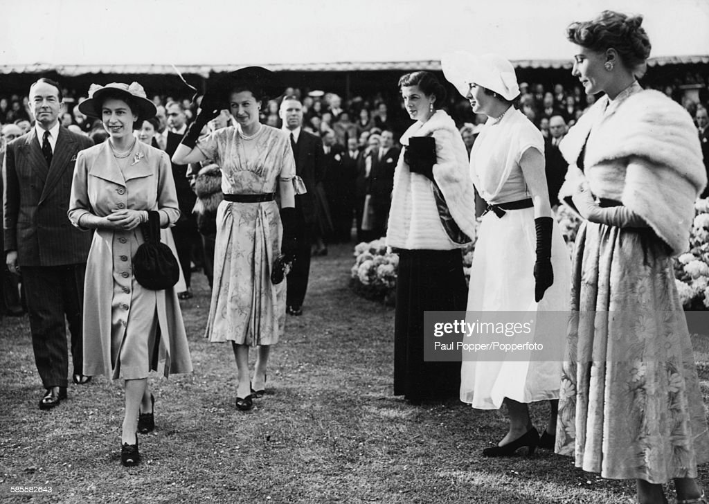 Princess Elizabeth walks past crowds of people during a fashion display in the grounds of Lancaster House London May 31st 1951