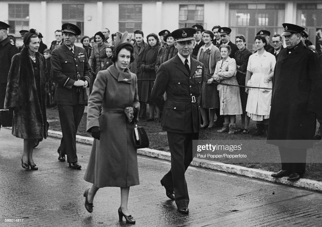 Princess Elizabeth walks with Arthur Tedder (1890-1967), Chief of Air Staff, followed by Lady Edwina Mountbatten as they arrive at London Airport, November 20th 1949. Princess Elizabeth is due to fly to Malta to meet with her husband Prince Philip.