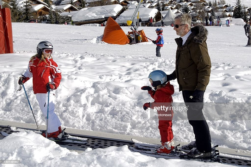 VERBIER , SWITZERLAND - FEBRUARY 22, 2012: Princess Elizabeth (L) with father Prince Philip (R) and sister Princess Eleanore (C) on the ski slopes during the Royal Family Skiing Holiday on February 22,2012 in Verbier,Switzerland.