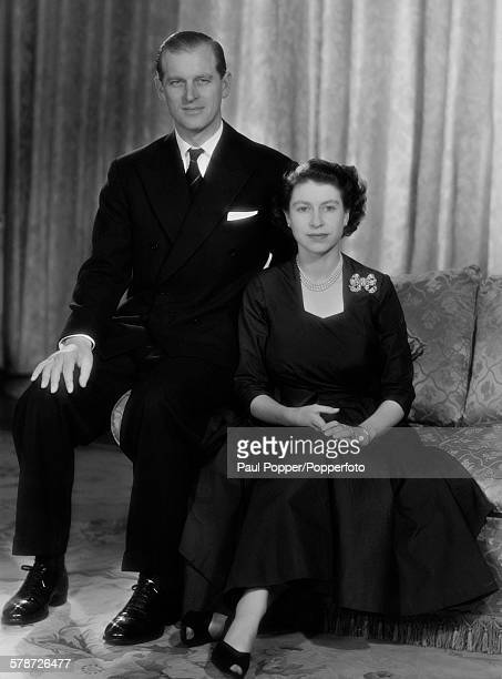 Princess Elizabeth with her husband the Duke of Edinburgh in the drawing room at Clarence House London January 1952 The Princess is wearing an...