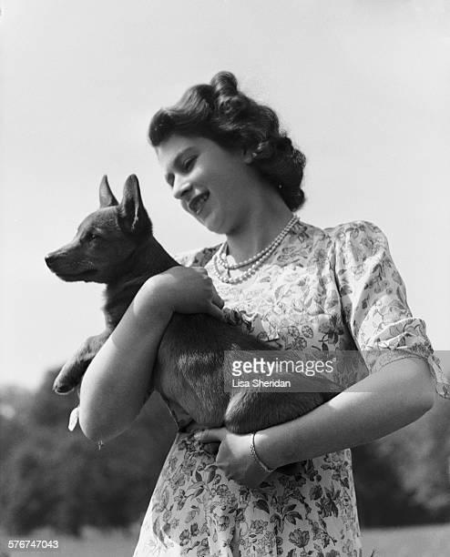 Princess Elizabeth with her pet Corgi Sue or Susan at Windsor Castle UK 30th May 1944