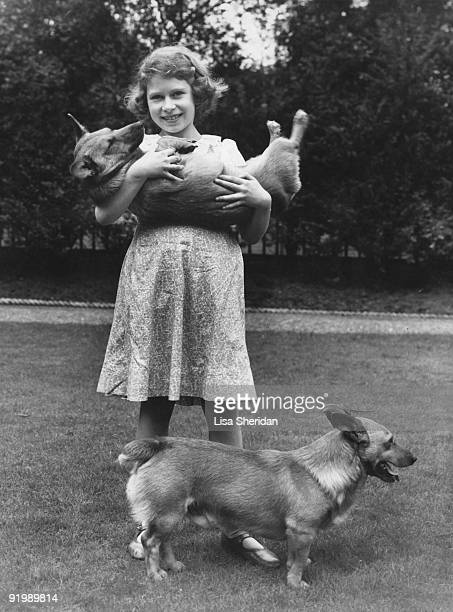 Princess Elizabeth with two corgi dogs at her home at 145 Piccadilly London July 1936
