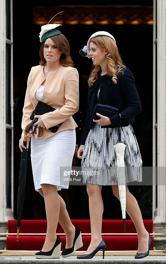 Princess Eugenie (L) and Princess Beatrice arrive for a garden party held at Buckingham Palace, on May 30, 2013 in London, England.