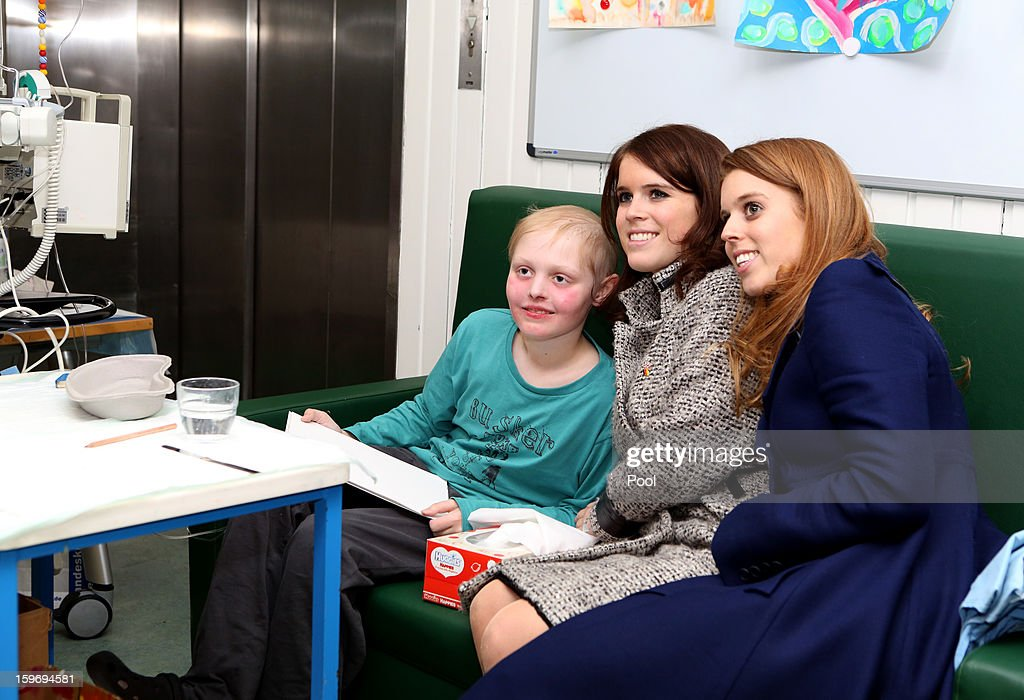 Princess Eugenie (C) and Princess Beatrice pose for a photo with patient Malte Wassmann (L), aged 12, during a visit to the Teenage Cancer Treatment Unit at the University of Medicine on January 18, 2013 in Hanover, Germany. The royal sisters are in Hanover on the second day of a two day visit to Germany. Yesterday the royals were in Berlin helping support GREAT, the British Government's initiative promoting the UK abroad.