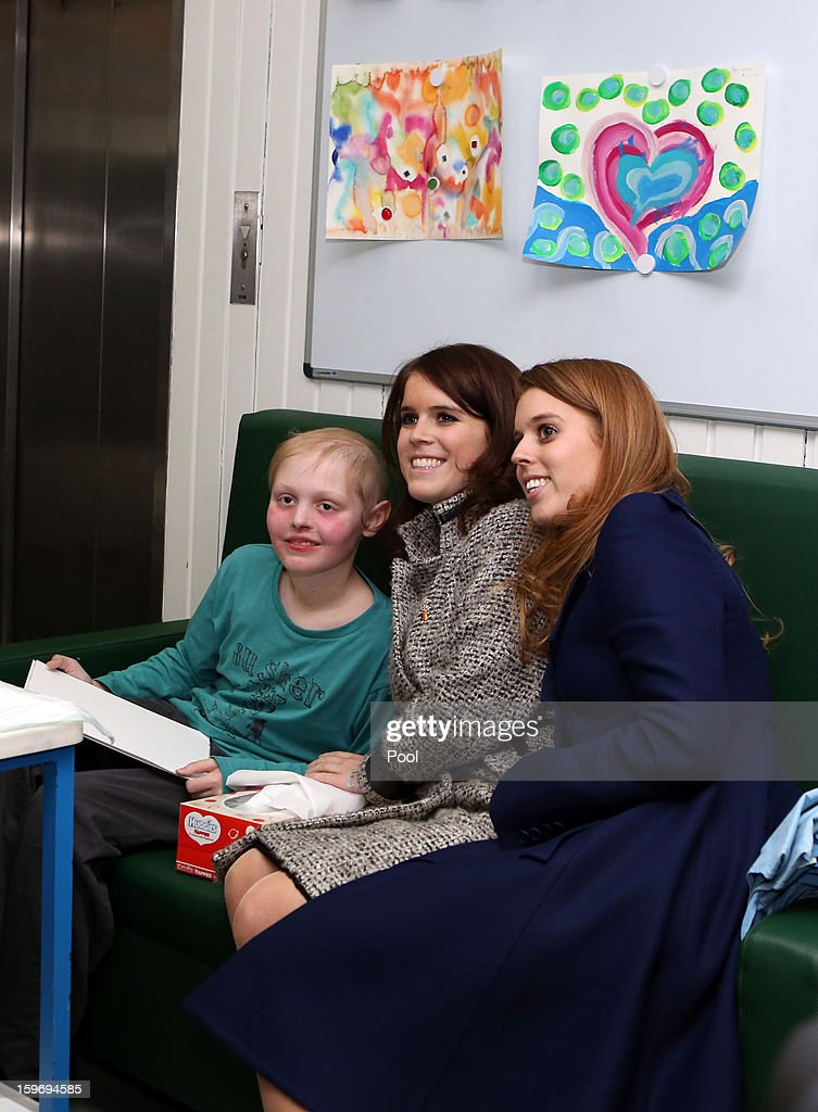 Princess Eugenie and Princess Beatrice pose for a photo with patient Malte Wassmann (L), aged 12, during a visit to the Teenage Cancer Treatment Unit at the University of Medicine on January 18, 2013 in Hanover, Germany. The royal sisters are in Hanover on the second day of a two day visit to Germany. Yesterday the royals were in Berlin helping support GREAT, the British Government's initiative promoting the UK abroad.