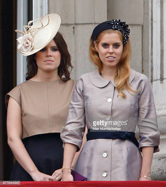 Princess Eugenie and Princess Beatrice stand on the balcony of Buckingham Palace during Trooping the Colour on June 13 2015 in London England The...