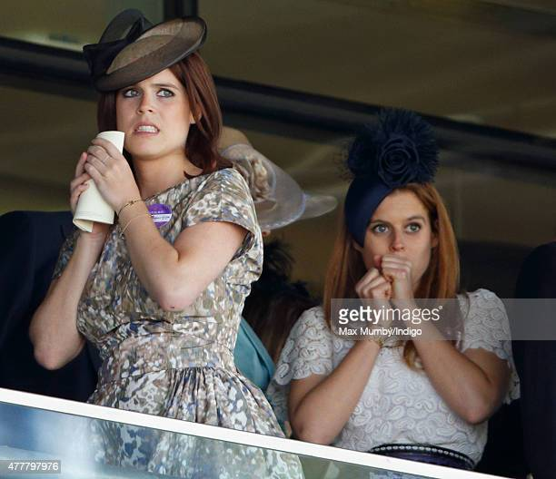 Princess Eugenie and Princess Beatrice watch the racing as they attend day 4 of Royal Ascot at Ascot Racecourse on June 19 2015 in Ascot England
