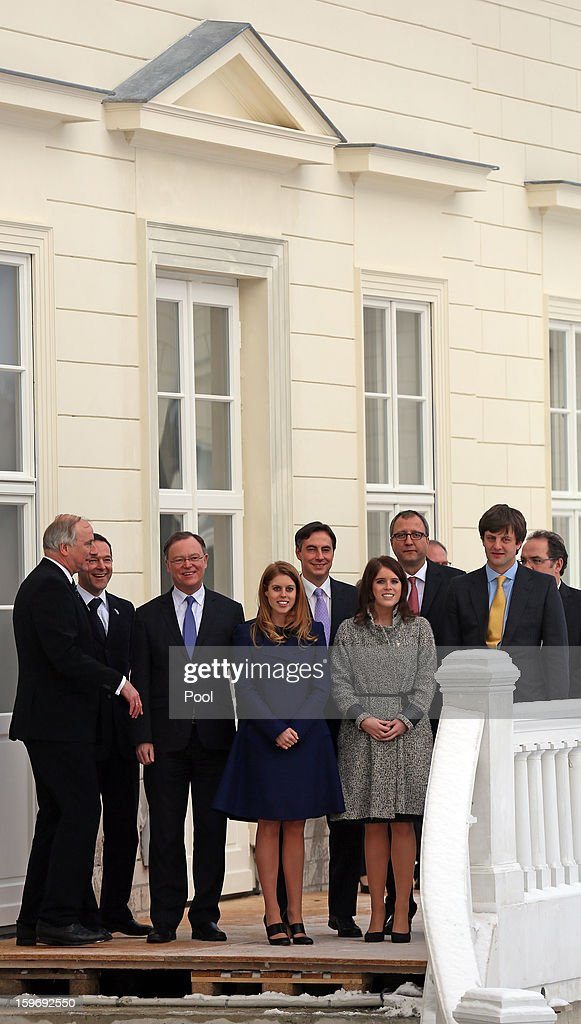 Princess Eugenie and Princess Beatrice with The Mayor of Hanover Stephan Weil (3L) and Ernst August, Prince of Hanover (far right) on the balcony of Herrenhausen Palace on January 18, 2013 in Hanover, Germany. The royal sisters are in Hanover on the second day of a two day visit to Germany. Yesterday the royals were in Berlin helping support GREAT, the British Government's initiative promoting the UK abroad.