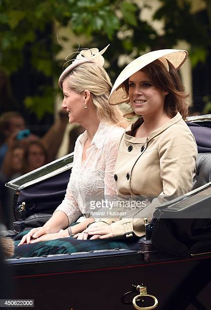 Princess Eugenie and Sophie Countess of Wessex travel in an open carriage during Trooping the Colour on June 14 2014 in London England