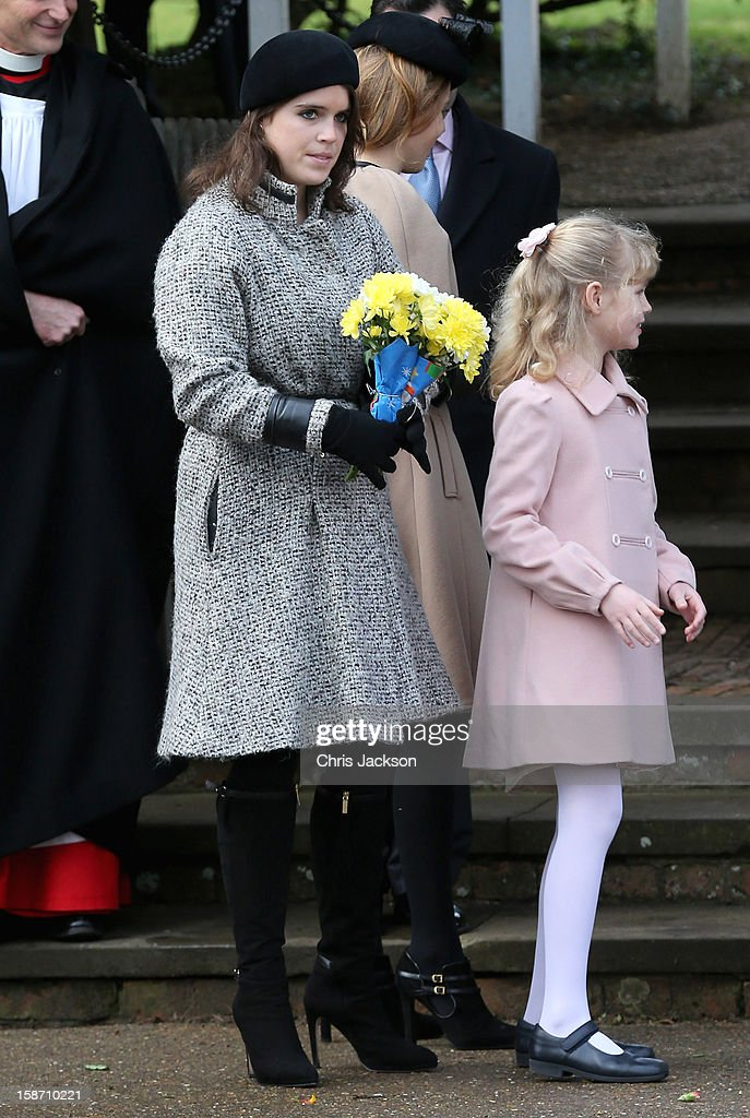 Princess Eugenie carries presented to the Queen, beside Lady Louise Windsor as they leave St Mary Magdalene Church after attending the traditional Christmas Day church service on December 25, 2012 in Sandringham near King's Lynn, England.
