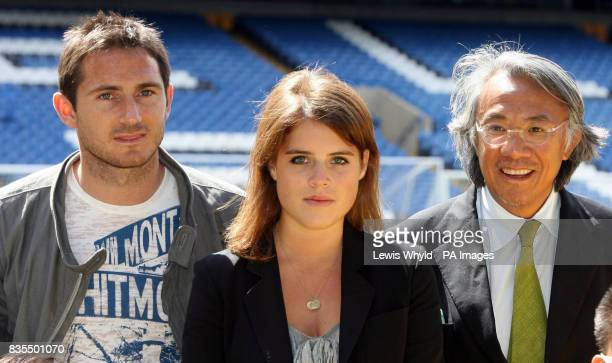 Princess Eugenie during a visit to Chelsea Football Club Stamford Bridge Fulham where she met with Sir David Tang right Chairman of the Hong Kong...