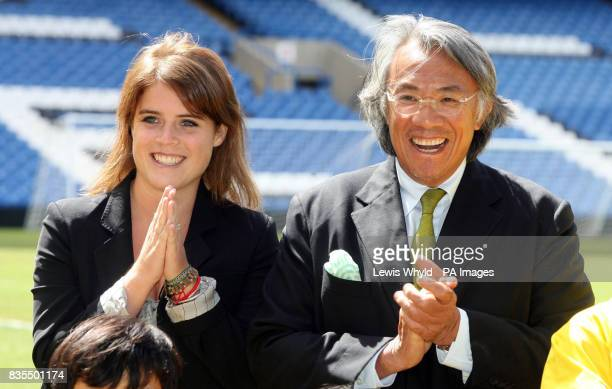 Princess Eugenie during a visit to Chelsea Football Club Stamford Bridge Fulham with Sir David Tang right Chairman of the Hong Kong Down Syndrome...
