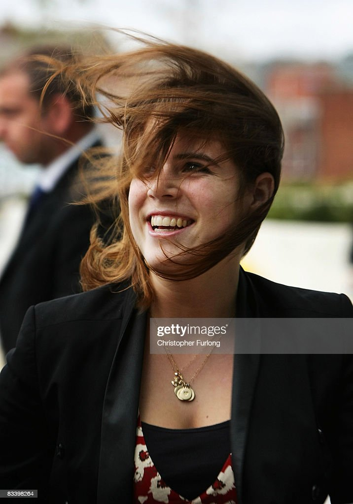 Princess Eugenie is blown around by high winds as she and her mother Sarah Ferguson, Duchess of York arrive at the new Teenage Cancer Unit at St James' Hospital on October 23, 2008 in Leeds, England. The Duchess has been Patron of The Teenage Cancer Trust since its inception 15 years ago. During the visit she introduced her daughter Eugenie to the work of the Trust enabling her to see first hand how important these units are. The nine bed centre is the Teenage Cancer Trust's ninth unit in the UK and cost the charity GBP1.25 million.