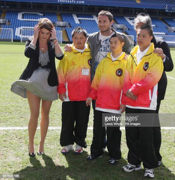 Princess Eugenie left during a visit to Chelsea Football Club Stamford Bridge Fulham where she met with Sir David Tang right Chairman of the Hong...