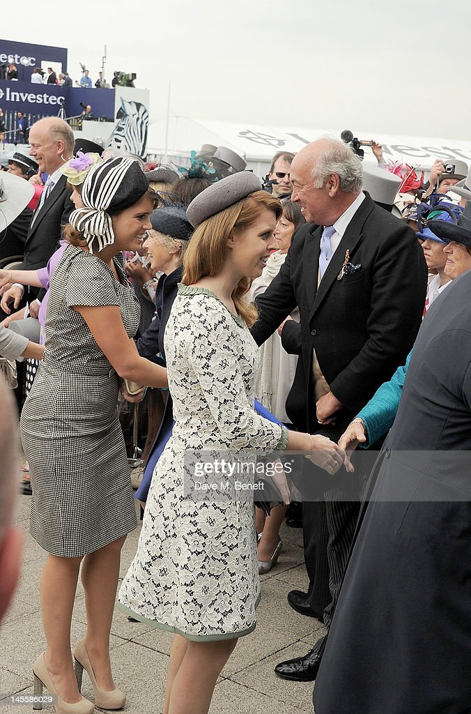 Princess Eugenie of York and Princess Beatrice of York attend Investec Derby Day at the Investec Derby Festival the first official event of the...