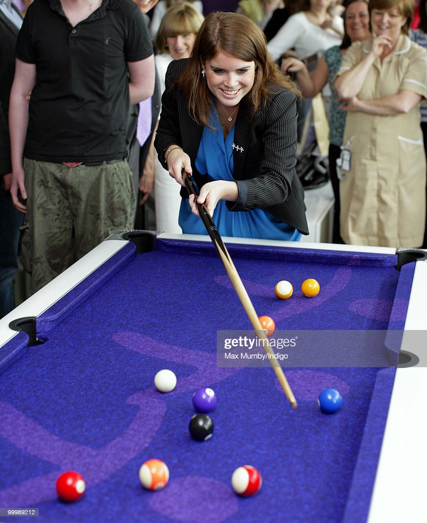 HRH Princess Eugenie of York plays pool as she attends the opening of the Teenage Cancer Trust Unit at the Great North Children's Hospital on May 19, 2010 in Newcastle upon Tyne, England.