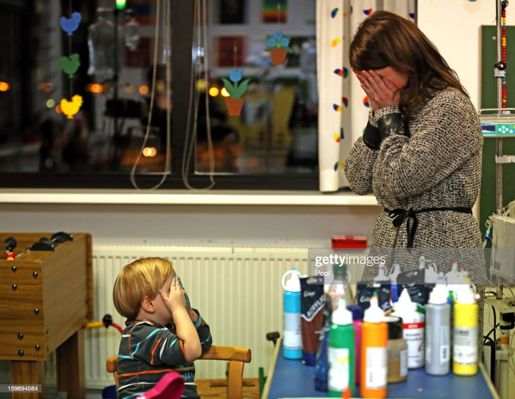 Princess Eugenie plays peek-a-boo with a young patient during a visit to the Teenage Cancer Treatment Unit at the University of Medicine on January 18, 2013 in Hanover, Germany. The royal sisters are in Hanover on the second day of a two day visit to Germany. Yesterday the royals were in Berlin helping support GREAT, the British Government's initiative promoting the UK abroad.