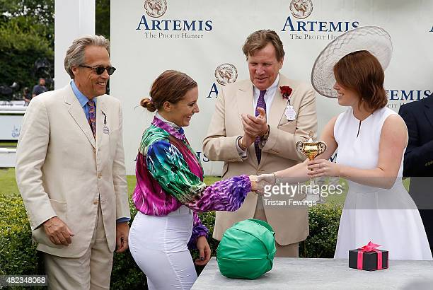 Princess Eugenie presents the winning jockey Camilla Henderson with the cup as Lord March and jeweller Theo Fennell look on on day three of the Qatar...