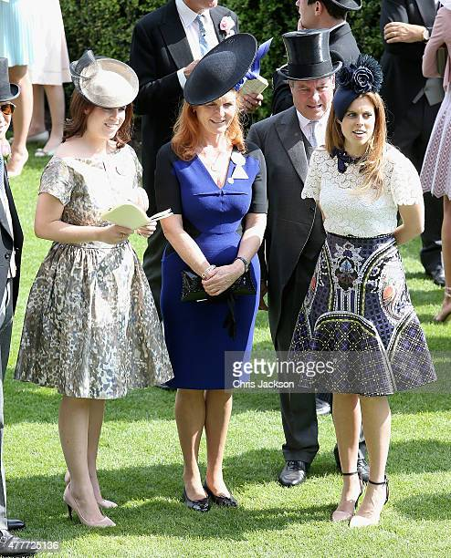 Princess Eugenie Princess Beatrice and Sarah Ferguson Duchess of York hold hands in the parade ring on day 4 of Royal Ascot at Ascot Racecourse on...