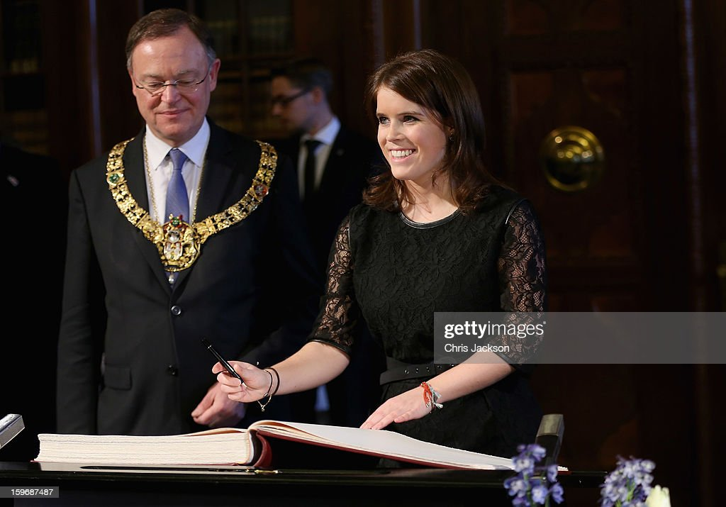 Princess Eugenie signs the Golden Book as Mayor of Hanover Stephan Weil looks on at Hanover City Hall on January 18, 2013 in Hanover, Germany. The royal sisters are in Hanover on the second day of a two day visit to Germany.Yesterday the royals were in Berlin helping support GREAT, the British Government's initiative promoting the UK abroad.