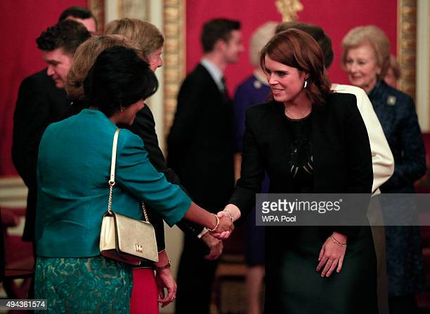 Princess Eugenie speaks to guests during a reception for The Queen Elizabeth Prize for Engineering in the Throne Room at Buckingham Palace on October...