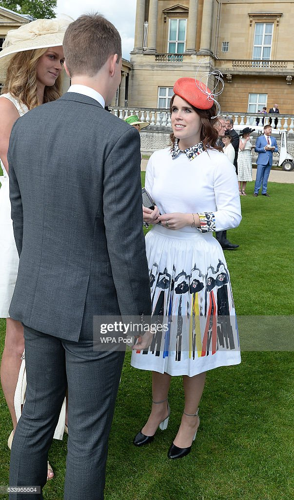 <a gi-track='captionPersonalityLinkClicked' href=/galleries/search?phrase=Princess+Eugenie&family=editorial&specificpeople=160237 ng-click='$event.stopPropagation()'>Princess Eugenie</a> (right) talks to guests during guests attending a garden party at Buckingham Palace on May 24, 2016 in London, England.