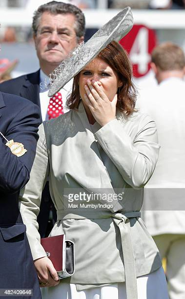 Princess Eugenie watches the racing as she attends day three of the Qatar Goodwood Festival at Goodwood Racecourse on July 30 2015 in Chichester...