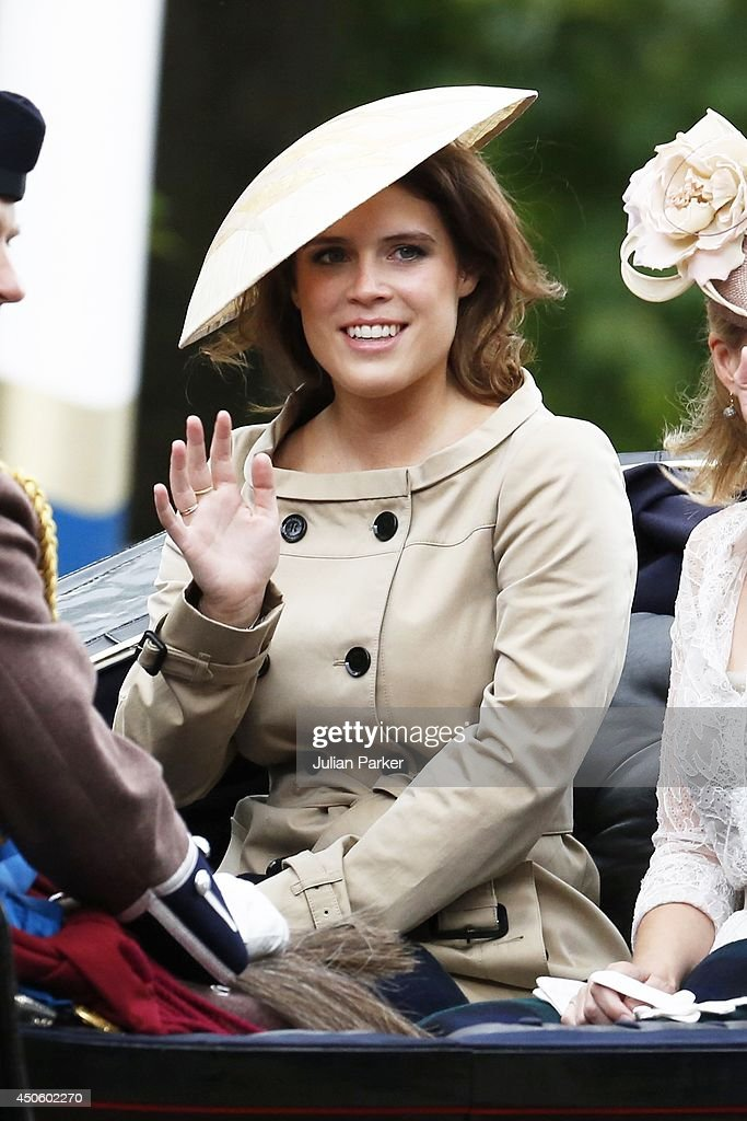 Princess Eugenie waves to the crowd during Trooping the Colour at The Royal Horseguards on June 14, 2014 in London, England.