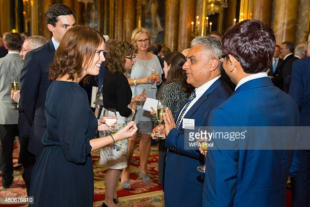 Princess Eugenie with Rajesh Samani and Bala Bhogadi of Premier Exports London Limited at a reception for winners of the Queen's Awards for...