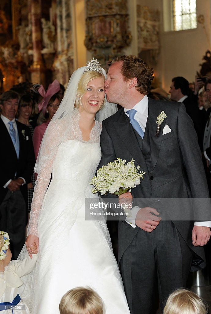 Princess Felipa von Bayern is kissed by her husband Christian Dienst after their wedding at Wieskirche on May 12, 2012 in Steingaden, Germany.