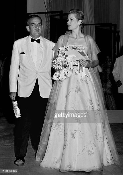 Princess Grace and her husband Prince Rainier of Monaco arrive 19 July 1958 at Monaco Sporting Club for the annual Red Cross gala ball